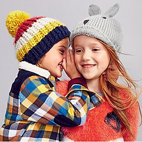 Children in colourful knitwear