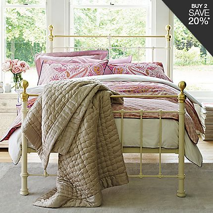 Castello bed frame with floral bedding