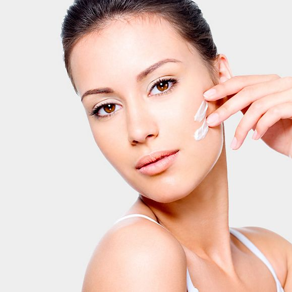 Woman using anti-ageing cream