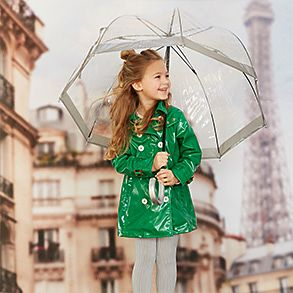 Girl wearing showerproof hooded green mac