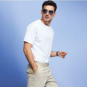 A man wearing a white t-shirt and chinos