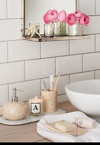 A ceramic soap dispenser soap dish and toothbrush mug