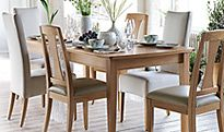 An extending dining table and dining chairs