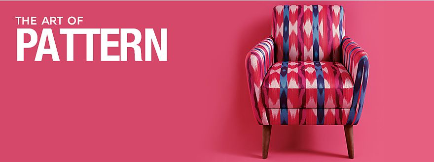 A pink and blue patterned chair