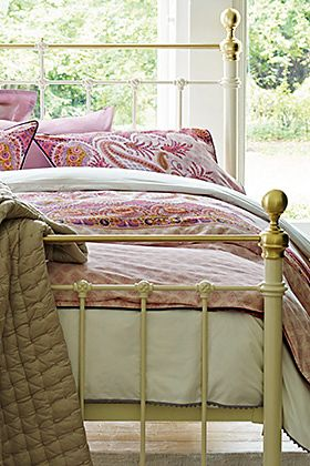White bed with pink bedding