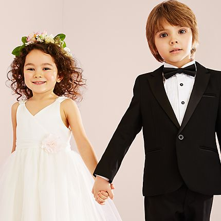 Two children in formal wedding outfits