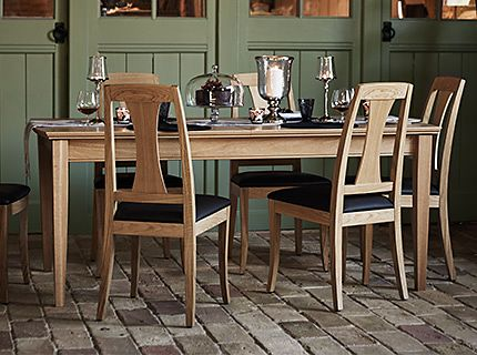 A wooden dining table and chairs from the dining furniture collection