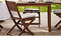 Patio furniture with seat pads on garden chairs