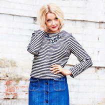 Lauren wears a Breton top and denim skirt