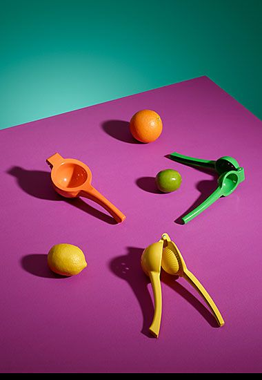 An orange squeezer, a lemon squeezer and a lime squeezer