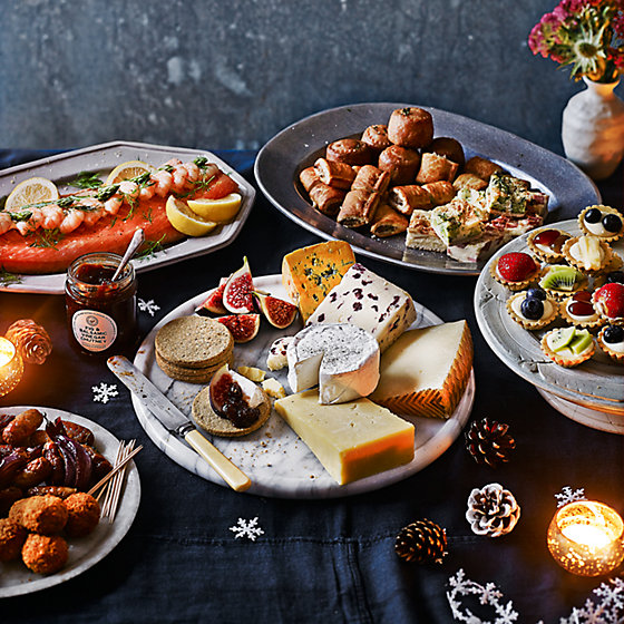A Selection Of Christmas Party Food To Order On Festive Table