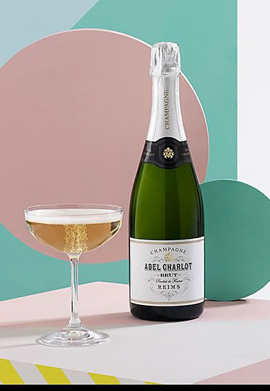 Bottle of Abel Charlot champagne with champagne saucer